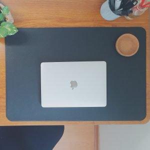 Macbook on desk mat